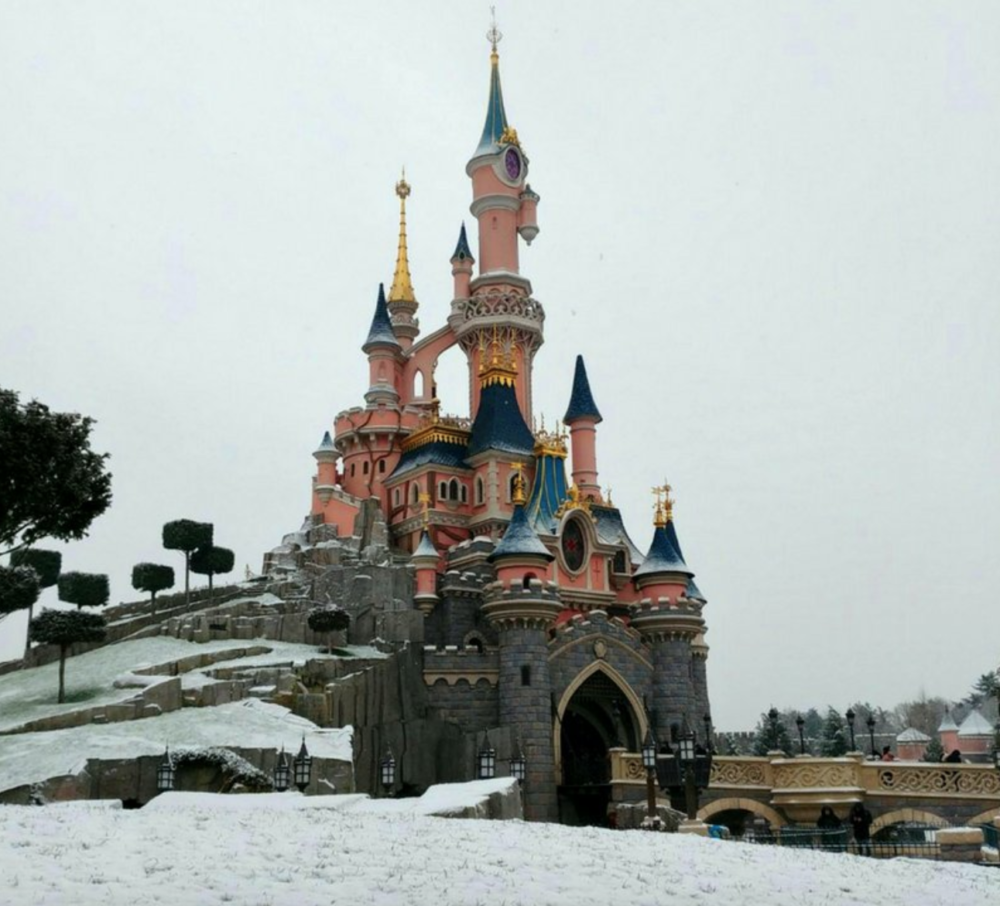 It snowed at Disneyland Paris, and the pictures look straight out of a winter dream