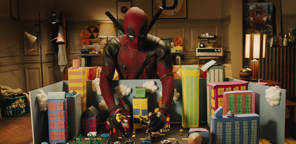 "Deadpool spoofs ""Justice League"" *and* ""Toy Story"" in the first full-length trailer for the sequel"