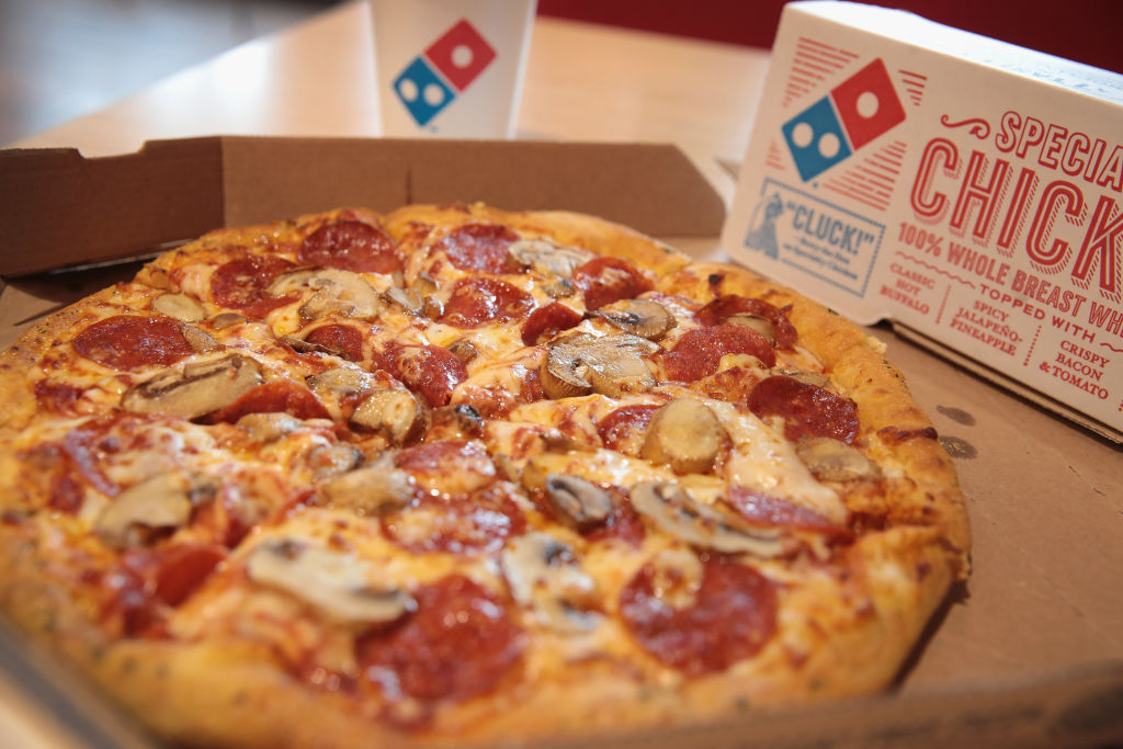 Domino's is going all out with these National Pizza Day deals, so grab that garlic sauce