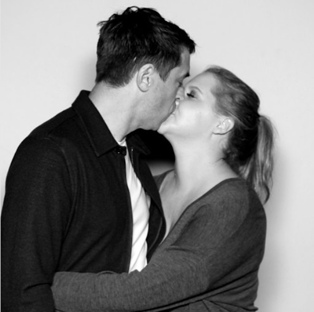 Amy Schumer just made her relationship with Chris Fischer Instagram official, and they packed on the PDA