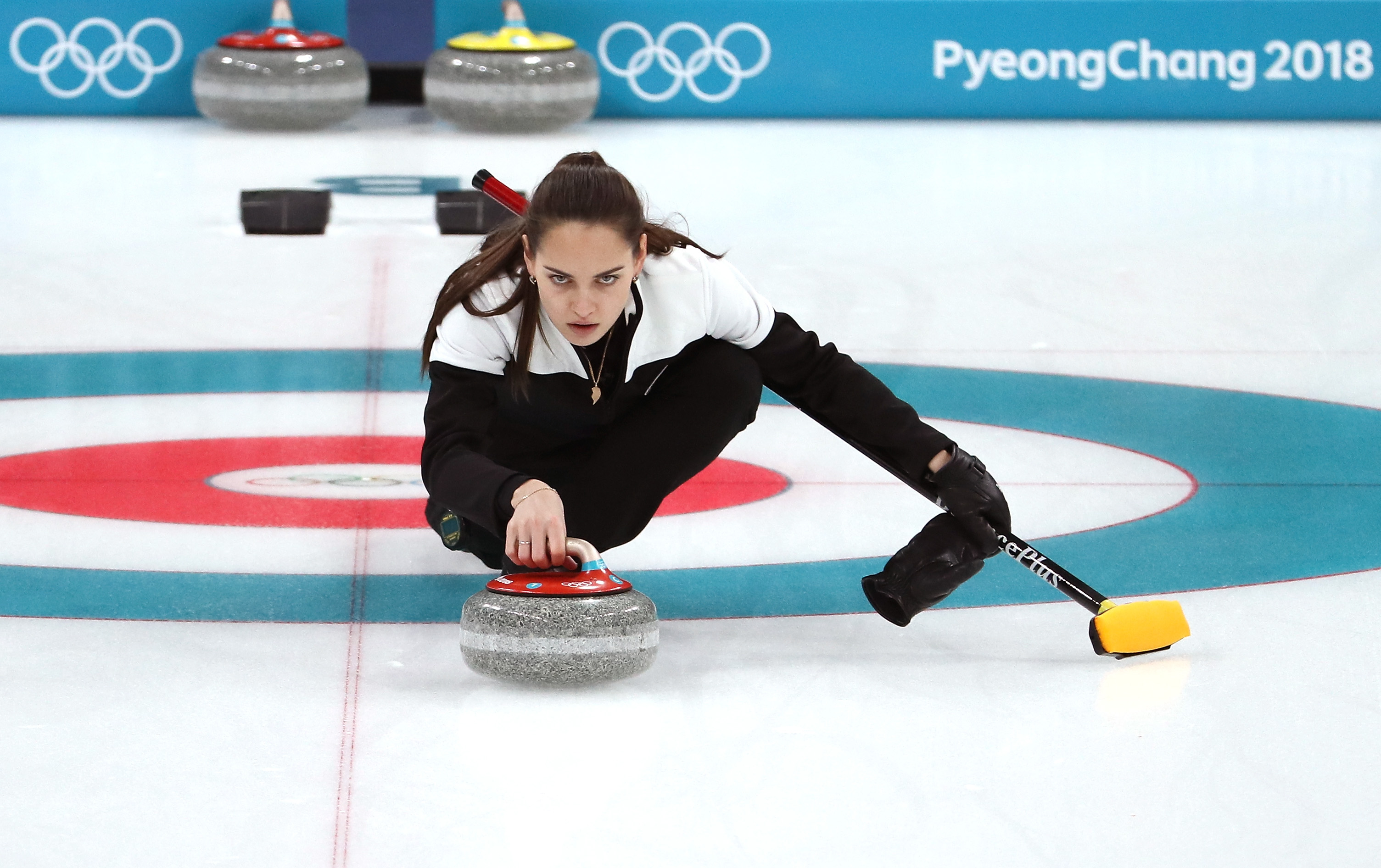 People are losing it over the Russian curler who fell — because she looks just like Angelina Jolie
