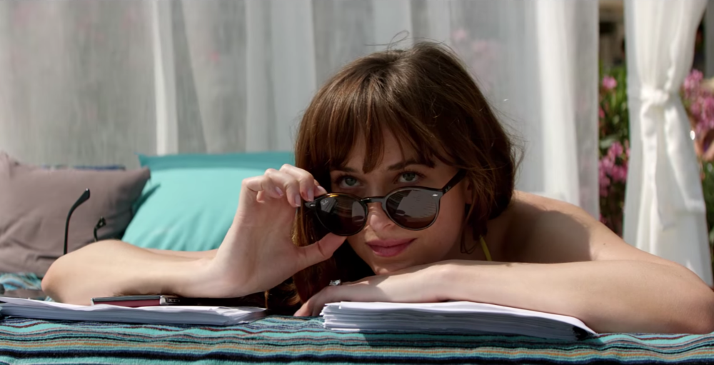 "Dakota Johnson had to have her thongs glued to her body for ""Fifty Shades Freed"""