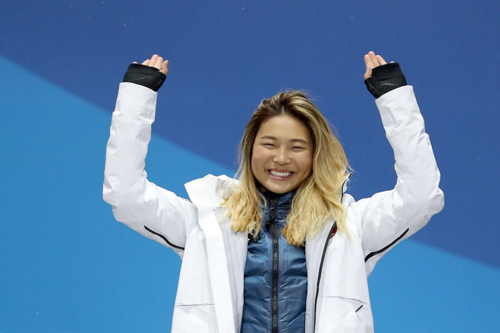 Chloe Kim's dad made a handmade sign to cheer on his daughter, and the internet can't handle it
