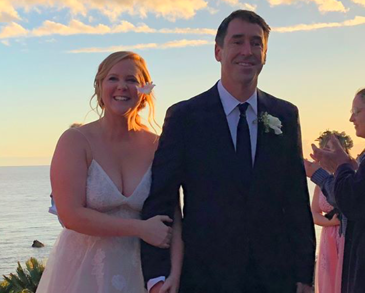 Amy Schumer confirmed she married Chris Fischer with the most beautiful photos from her beach wedding