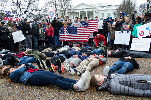 """Students protested gun violence today with a """"lie-in"""" outside the White House"""