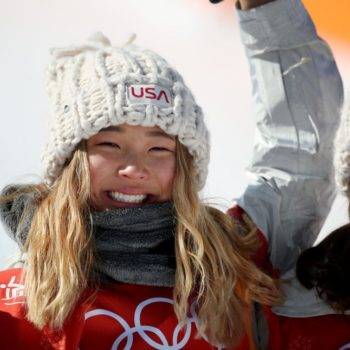 "Chloe Kim posed on the cover of ""Sports Illustrated"" with her beloved doggo, and it's exactly what you need right now"