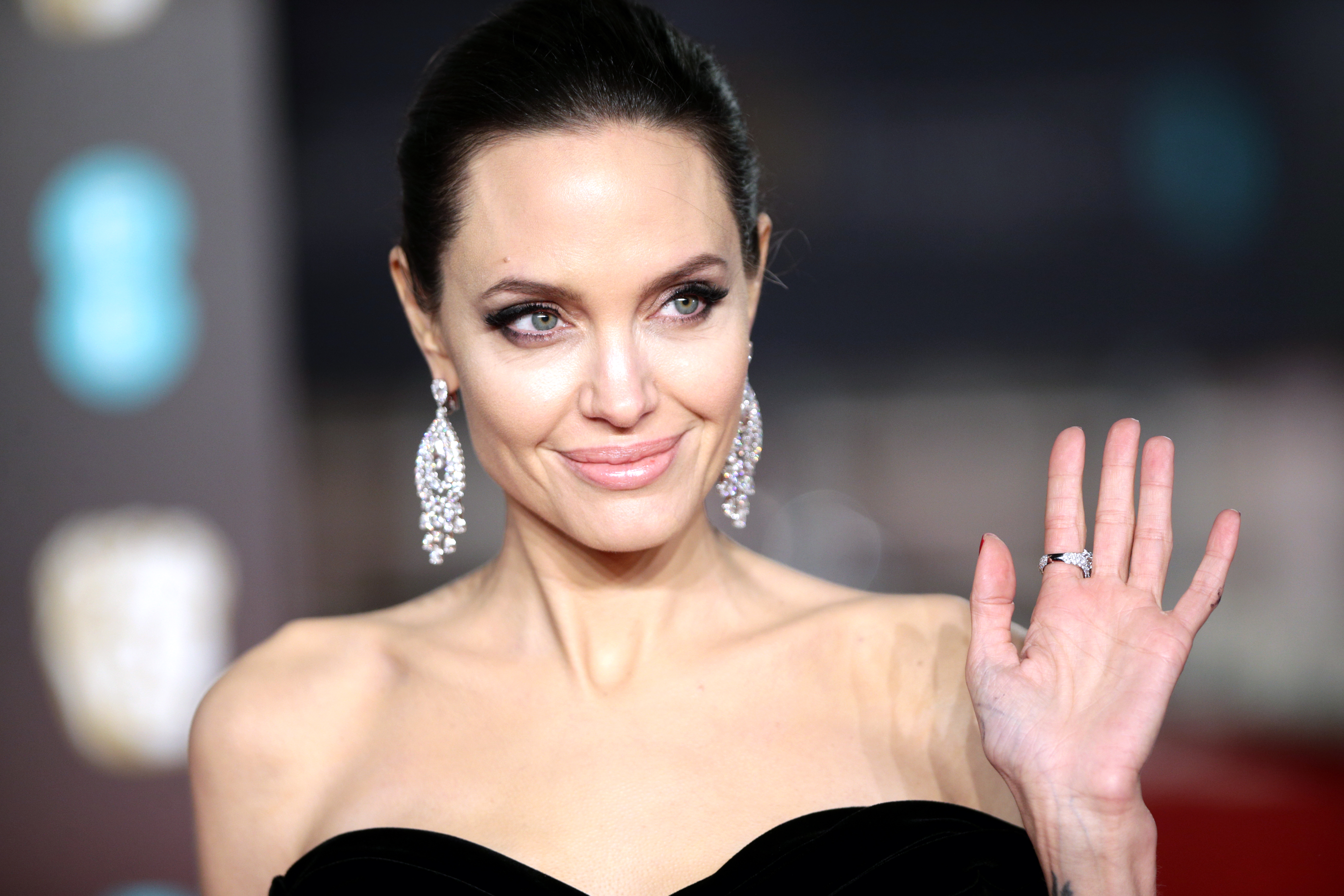 Angelina Jolie wore a seriously sparkly caftan this weekend, and it's a major change for her