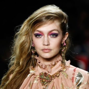 People are not thrilled with Gigi Hadid for carrying a puppy down the runway at Milan Fashion Week