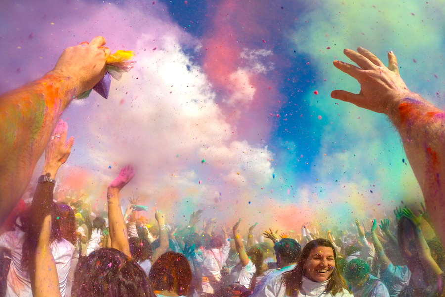 What is Holi, and why do people throw colored powder to celebrate?