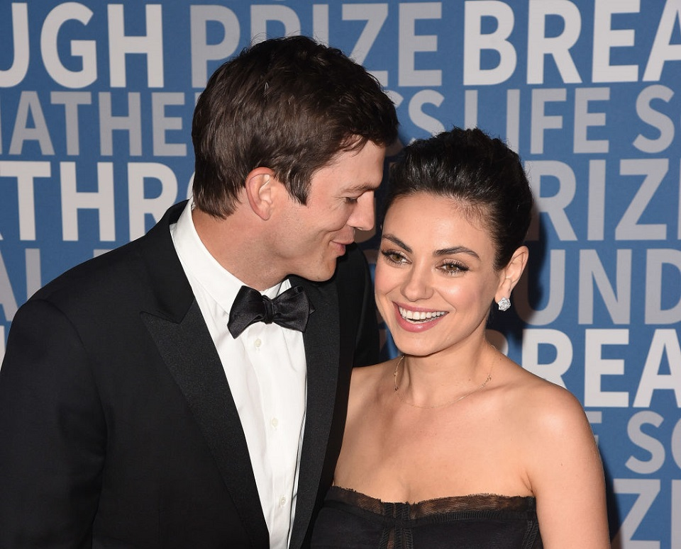 Ashton Kutcher and Mila Kunis got caught on a kiss cam, and whoa, it was passionate