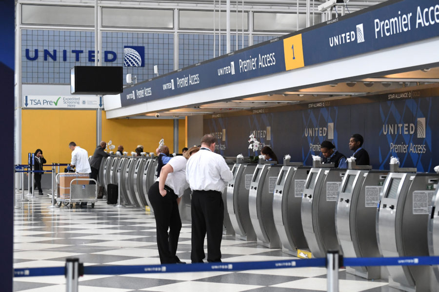 "A United Airlines employee freaked out over a passenger's carry-on because it was ""oversized"""