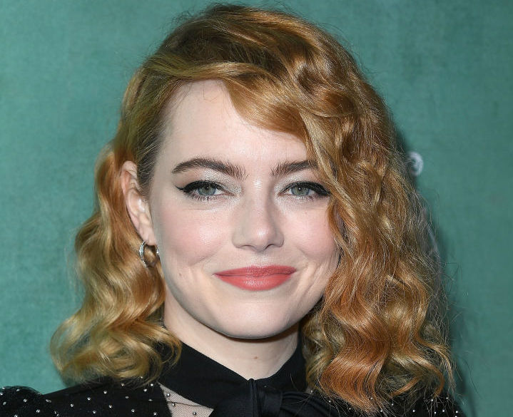 Emma Stone is serving sexy goth cowgirl vibes, and we love this look on her