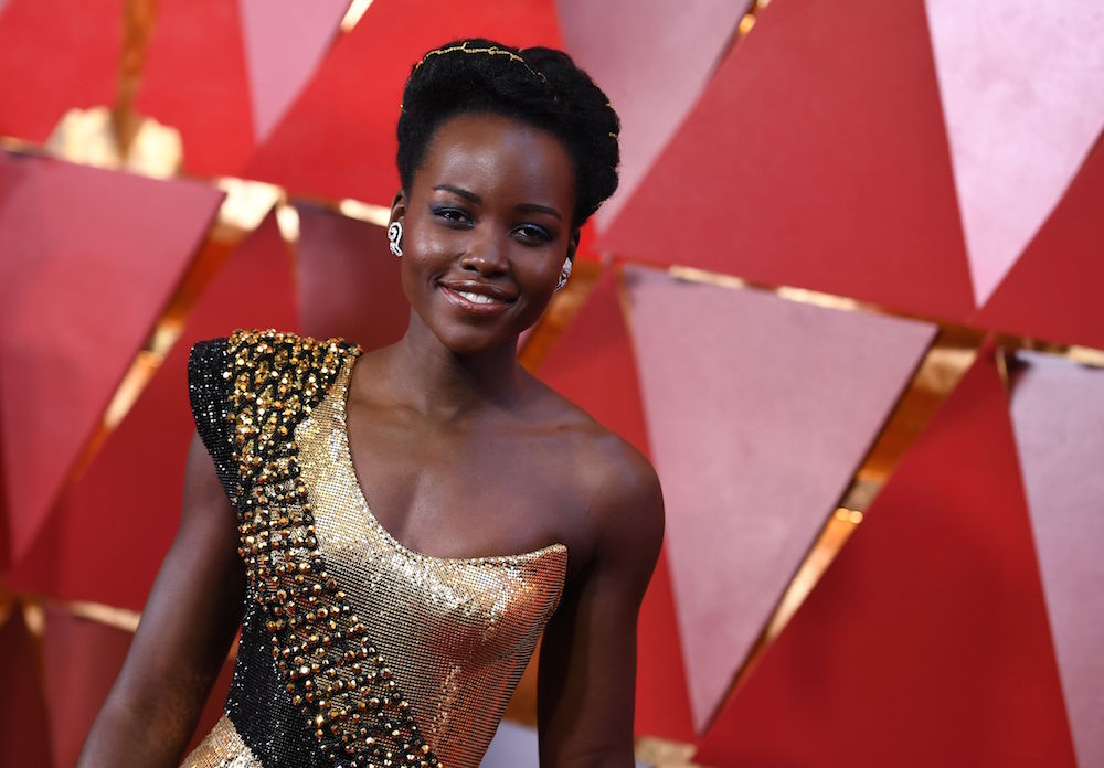 Lupita Nyong'o invoked Wakandan fierceness with her gold sequined gown