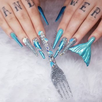 "This nail artist created ""The Little Mermaid""-inspired nails using an actual dinglehopper"