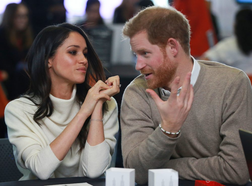 Prince Harry got caught giving Meghan Markle a *look* after a Liam Payne performance, and we're confused but swooning