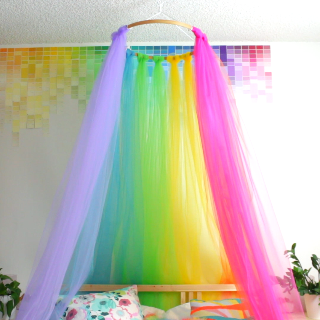 Sleep beneath a rainbow every night with this easy DIY rainbow canopy