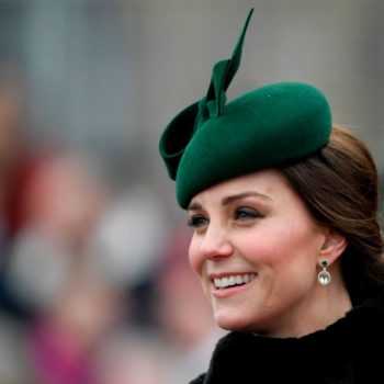Kate Middleton celebrated St. Patrick's Day in a gorgeous green coat and got to pet a dog, so not a bad day