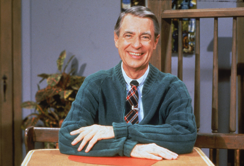 To be clear, Tom Hanks's Mr. Rogers movie is NOT a biopic — but it'll still inspire the hell out of you