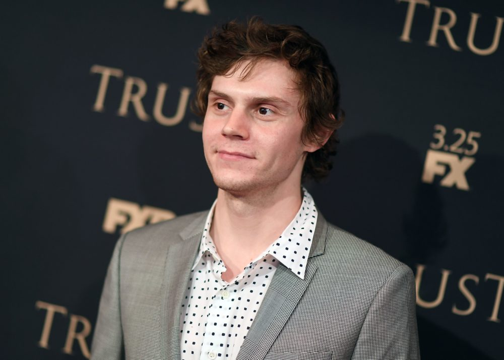 Evan Peters just teased a BTS picture from <em>American Horror Story</em> Season 8 — and once again, he has crazy hair