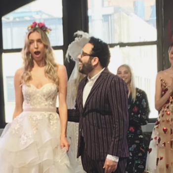 This guy proposed to his model girlfriend while she was walking the runway in a *wedding gown*