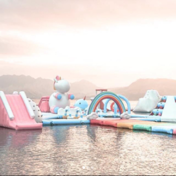 This unicorn-themed inflatable water park is the beach vacation of our dreams