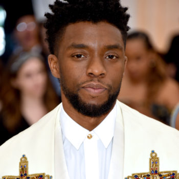 Chadwick Boseman looks like he's answering Bradley Cooper's prayers in this Met Gala photobomb