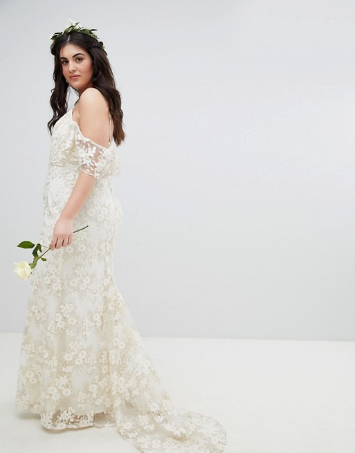 03e1db1dcf6 14 Affordable Plus-Size Wedding Dresses That Cost Under  400 ...