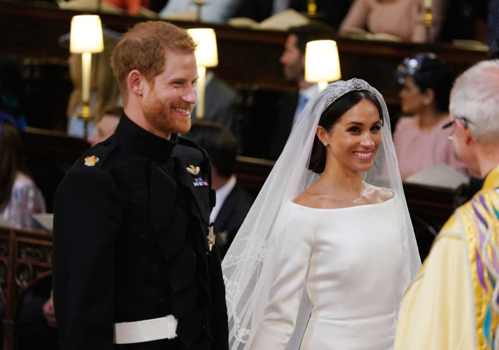 It appears as if Prince Harry excitedly swore under his breath when he saw Meghan for the first time at the royal wedding