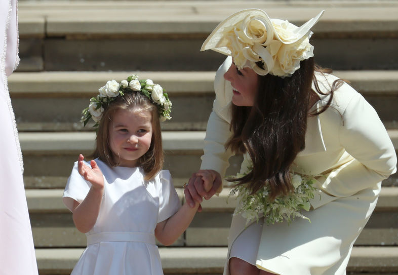 Prince George and Princess Charlotte had their royal waves down pat at the royal wedding