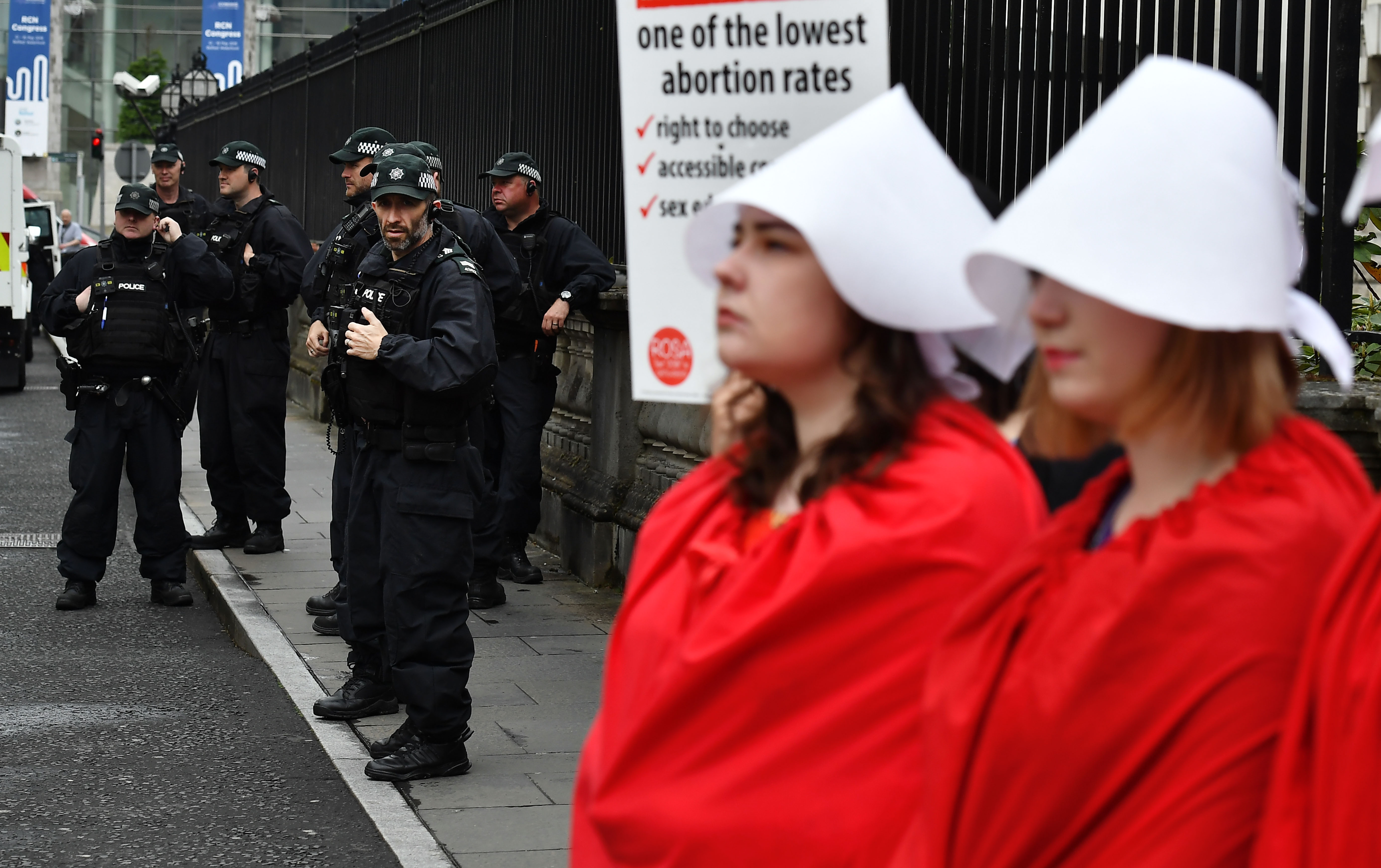 Women in Northern Ireland dressed like Handmaids and took the abortion pill to protest the country's abortion ban