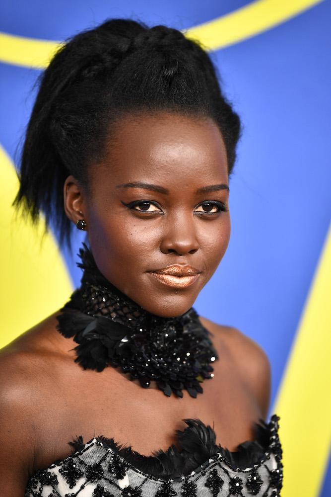 Lupita Nyong'o used eyeshadow on her lips for this golden look, and we're taking notes