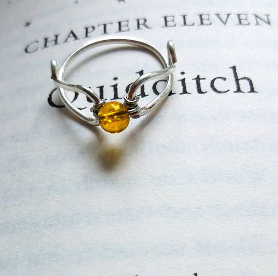 This Harry Potter Themed Engagement Ring Reps All Four Houses