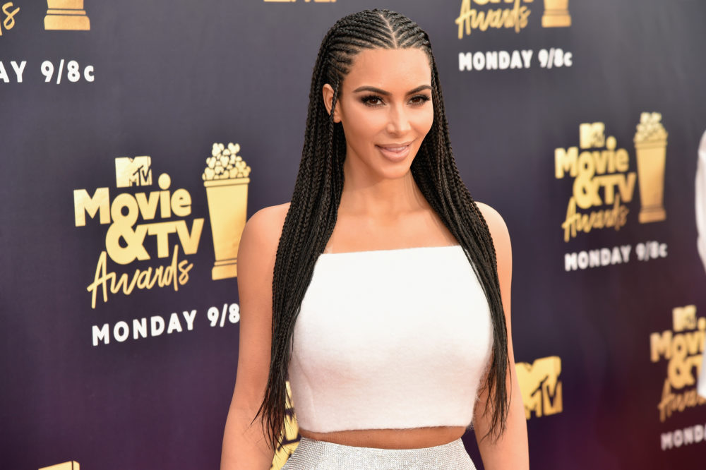 Kim Kardashian just directly responded to criticism about straightening North's hair and wearing fulani braids — again