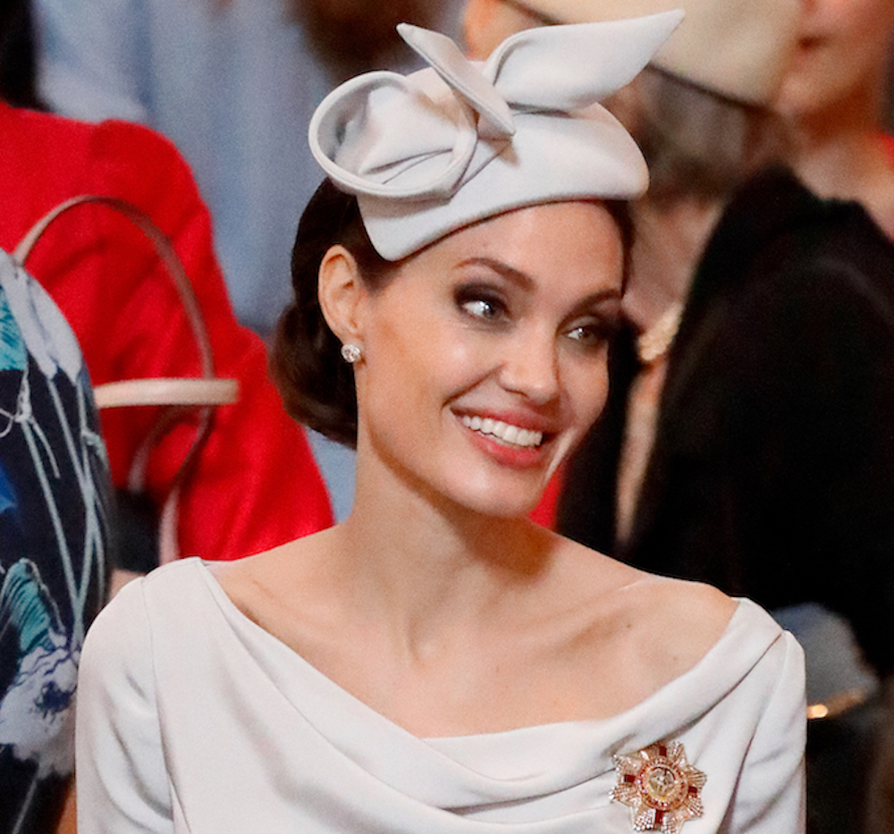 Angelina Jolie took a style cue from Meghan Markle and looks like a royal herself