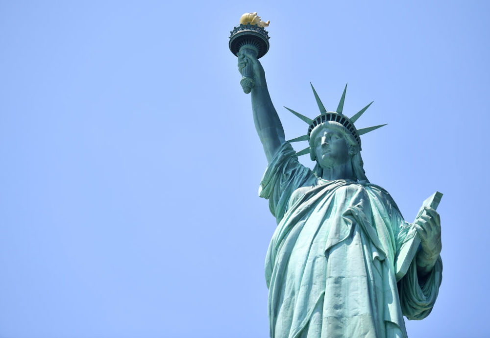 A woman was arrested on July 4th for climbing the Statue of Liberty to protest Trump's immigration policy