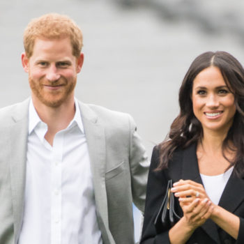 These photos of Prince Harry and Meghan Markle playing with an adorable toddler will make your ovaries hurt