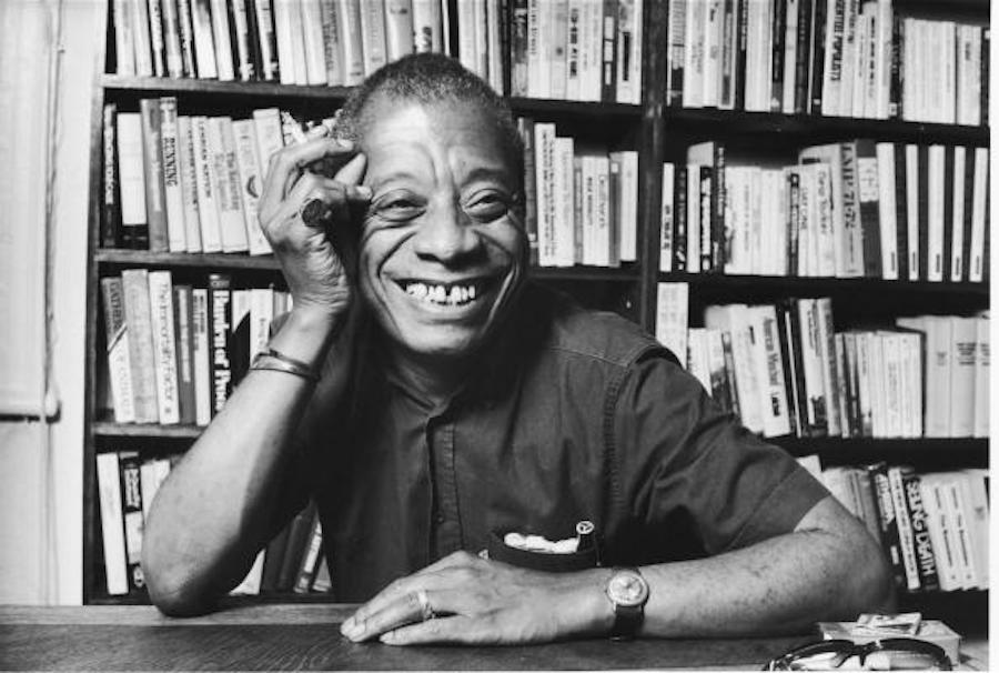 James Baldwin with Books