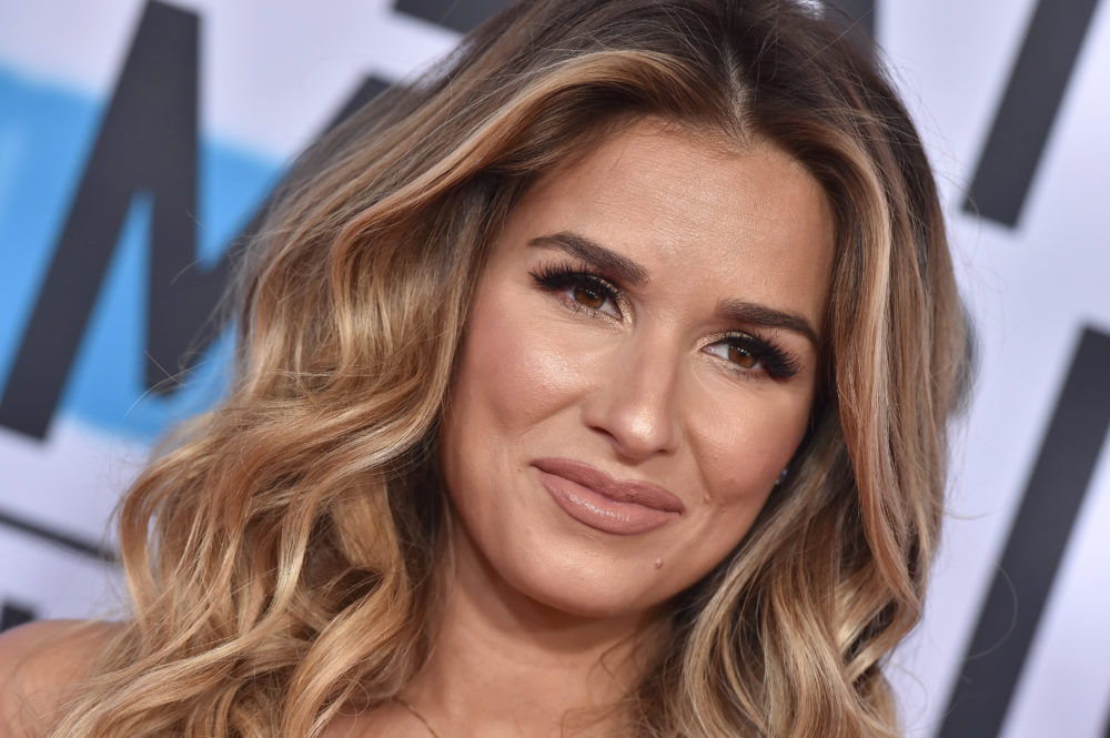 Jessie James Decker posed with a glass of wine while breastfeeding, and the mommy shamers came out in full force