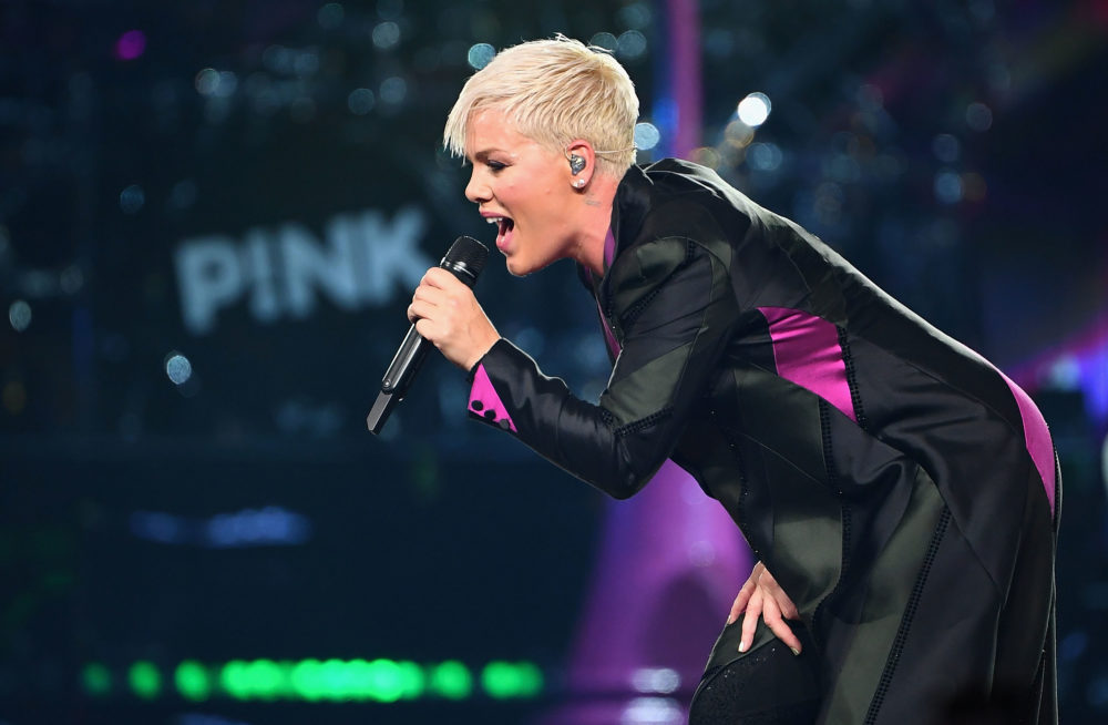 Pink clapped back after a tabloid accused her of canceling a concert to hang out at the beach