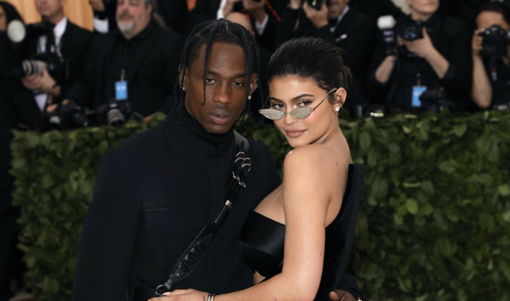 Kylie Jenner appears in Travis Scott's new music video naked and drenched in gold, as you do