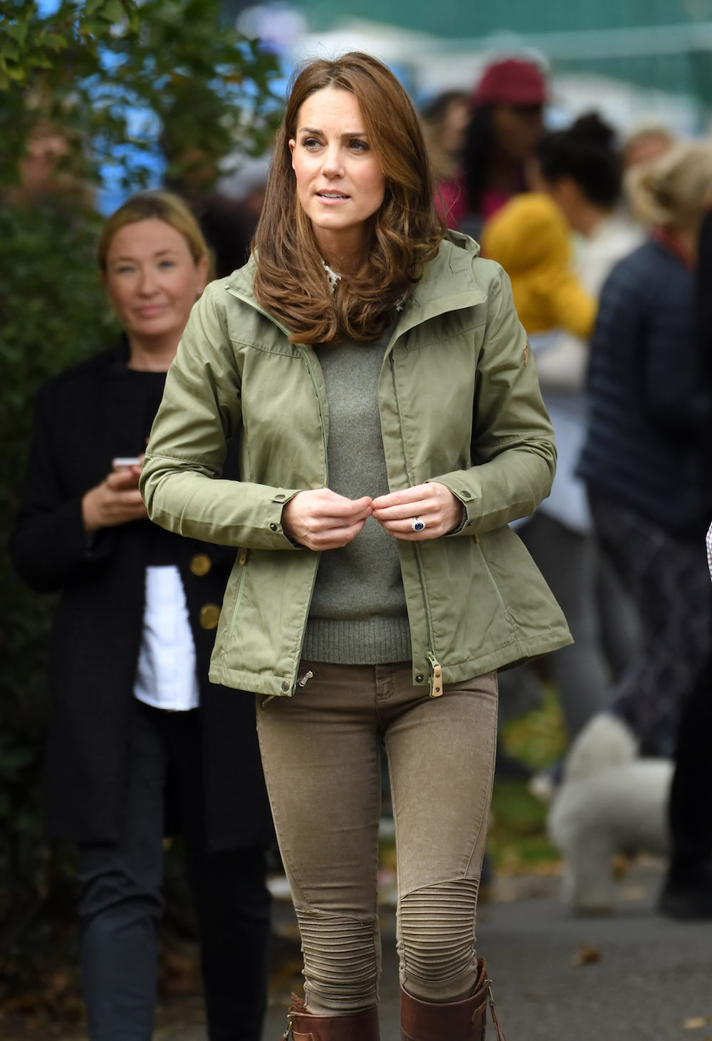 61d6a33b The Duchess of Cambridge paired her Zara jeans with an olive-toned coat, a  matching sweater, and brown knee-length boots.