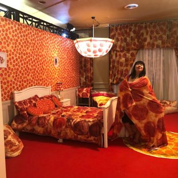 The president of a pizza club visits a pop-up museum that is entirely pizza-themed