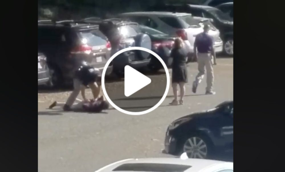 A white school resource officer allegedly tackled a 14-year-old black girl to the ground