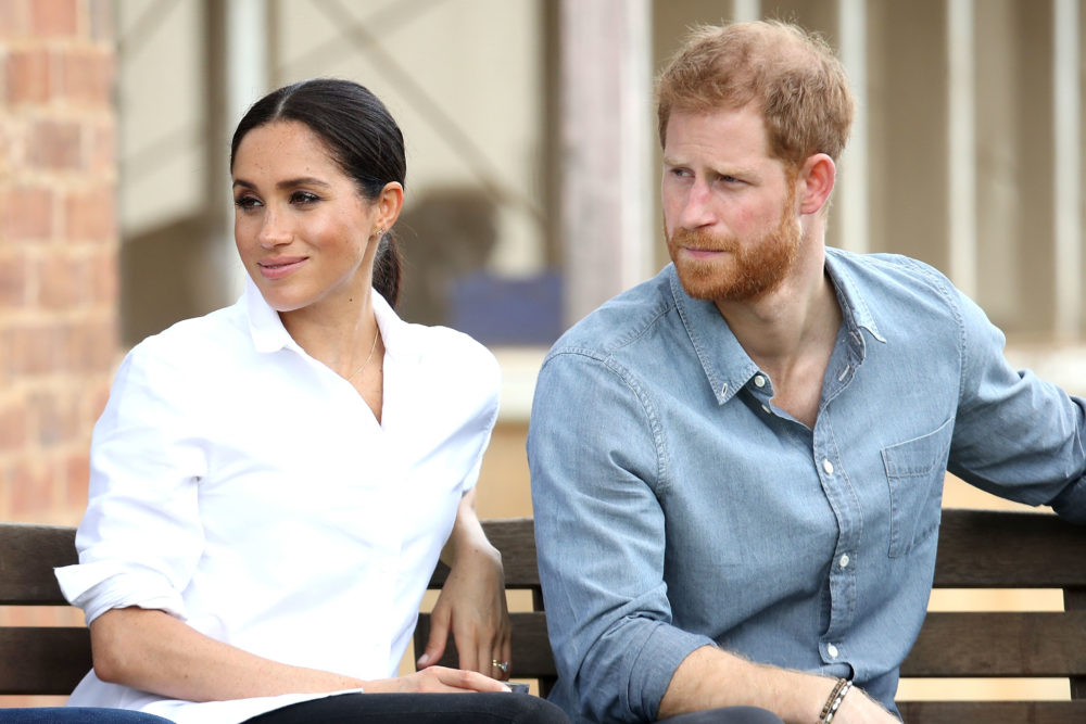 These pics of Meghan Markle protecting Prince Harry from rain are #COUPLEGOALS