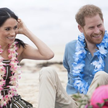 Harry and Meghan just showed so much non-royal PDA on a beach in Australia