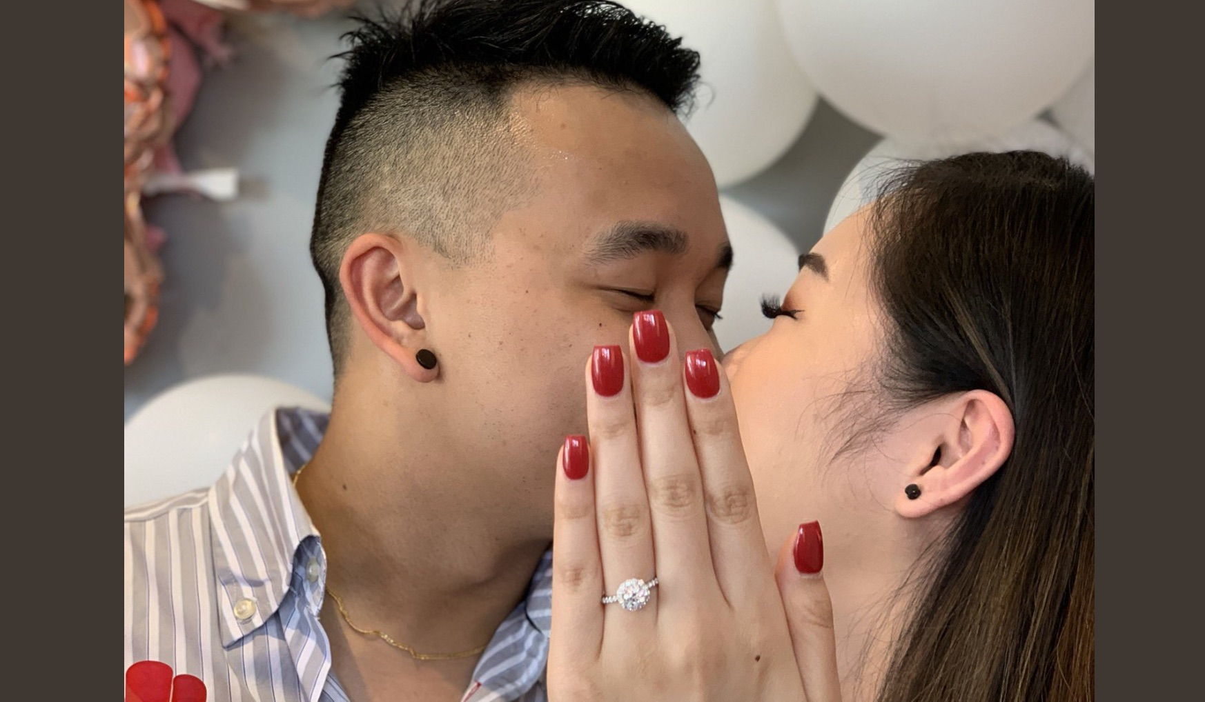 "This couple's viral engagement photo featured the most genius ""perfect manicure"" hack ever"