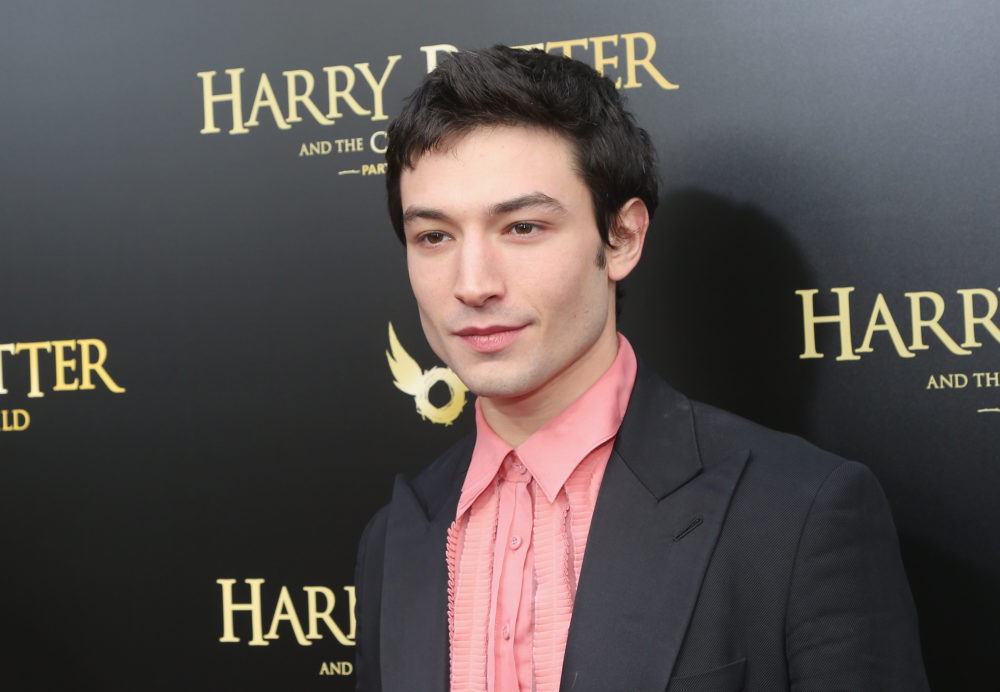 "Ezra Miller wore a ""sassy sleeping bag"" to the <em>Grindelwald </em>premiere, and Twitter is obsessed"