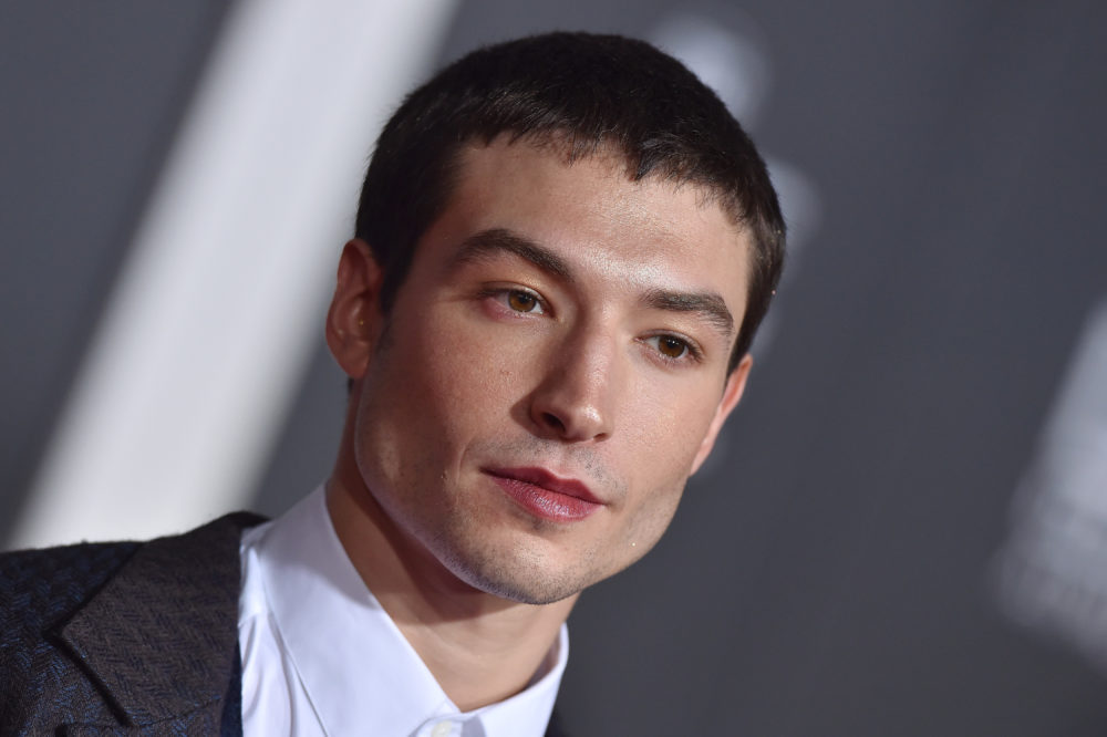 "Ezra Miller just did the ""unforgivable"" with his latest feathery red carpet look"