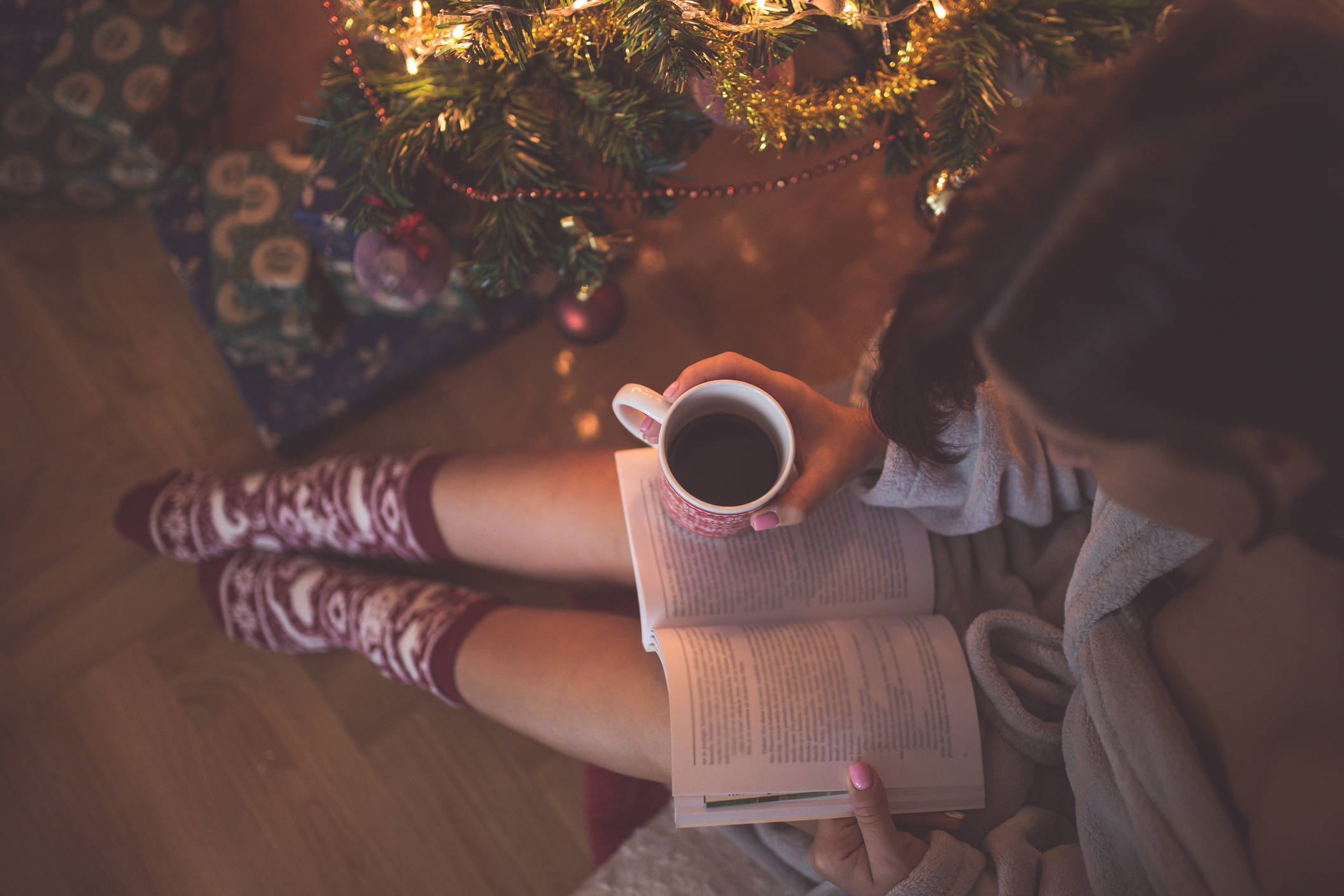 11 cozy holiday books to read by the fire with a mug of mulled wine