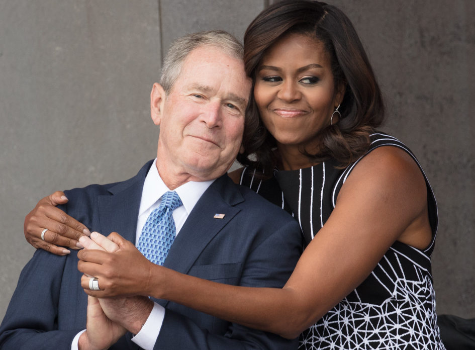 George W. Bush slipped Michelle Obama a piece of candy again at his father's funeral service, and aw